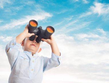Boy looking through the binoculars