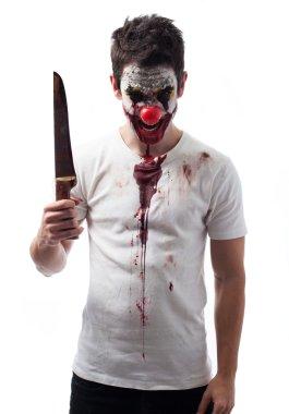 Evil clown holding a knife