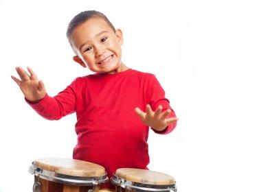 Boy playing on bongos