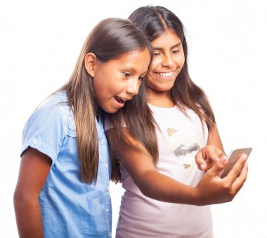 Girl showing something to her friend