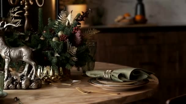 Christmas table decoration, Banquet table with glasses before serving food, Close-up of Christmas dinner table with seasonal decorations, crystal glasses and decorative deer