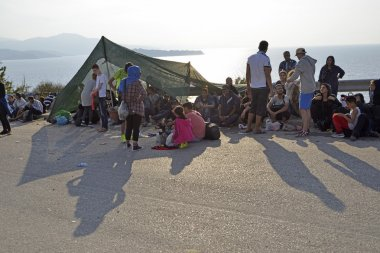 refugee migrants, arrived on Lesvos in inflatable dinghy boats