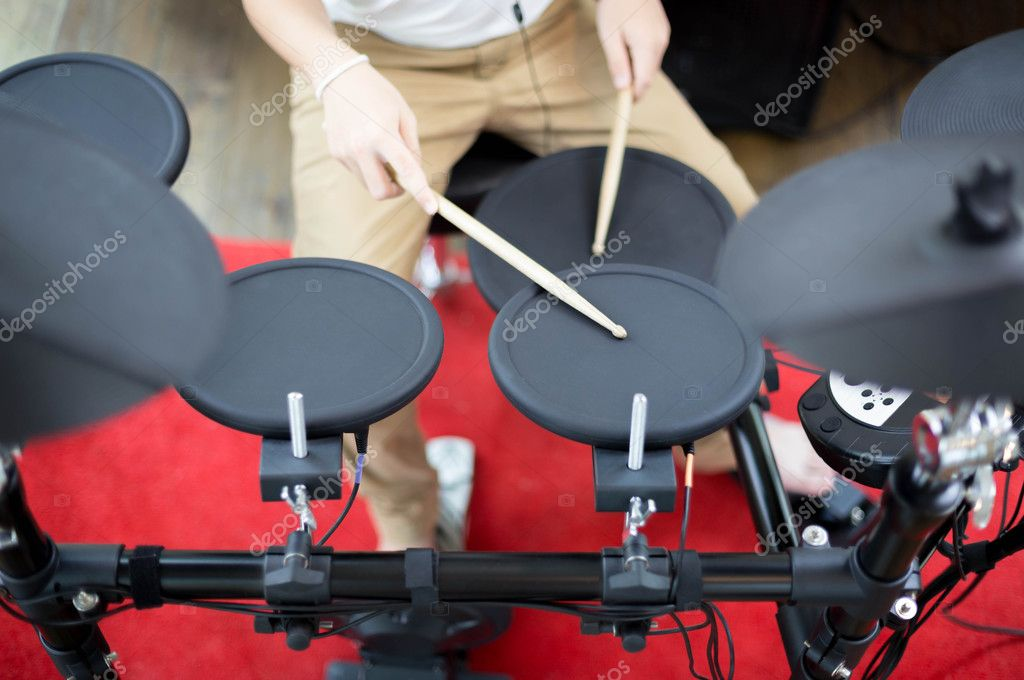Asian boy learning play electronic drum