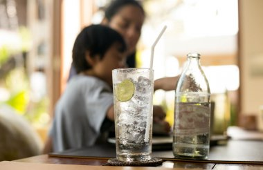 Healthy nutrition of drinking water with lemon and woman