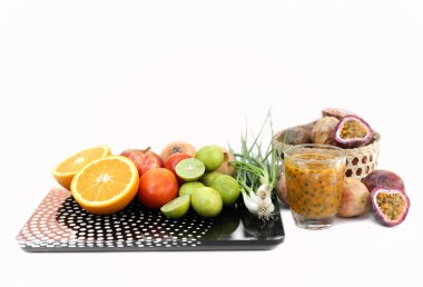 Diet concept. Fruits and vegetable with on  weight scal