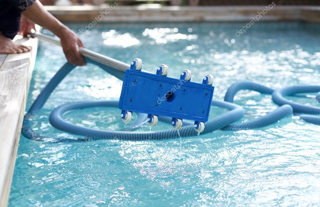 Man holding an equipment for cleaning  swimming pool