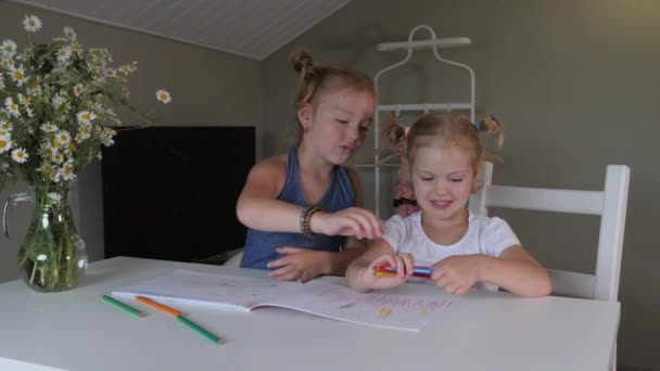 Two similar blonde girls with freckles draw with colored pencils in the album.