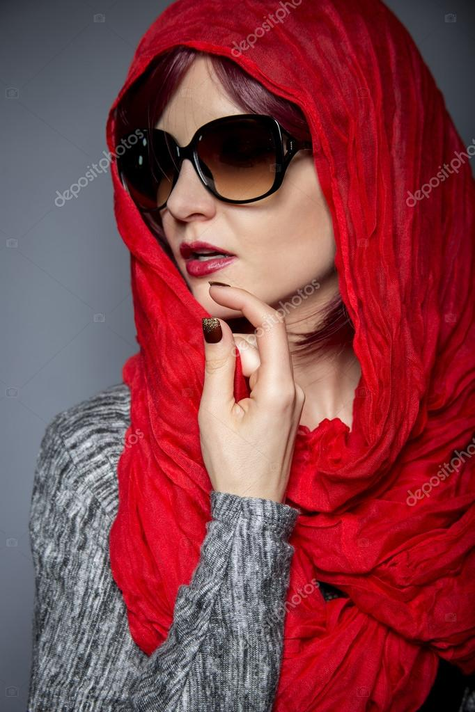 37deb168ea6f5 Beautiful woman with modern fashion red head scarf or Hijab — Photo by  innovatedcaptures