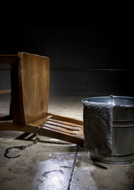 Torture chamber with a water bucket
