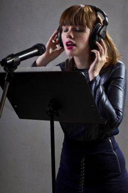 Singer reading lyrics