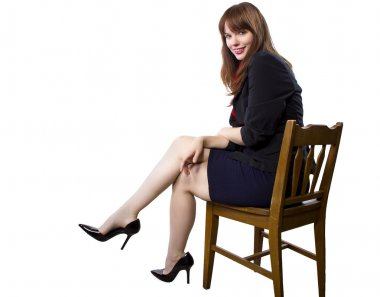 Female Executive sitting on a chair