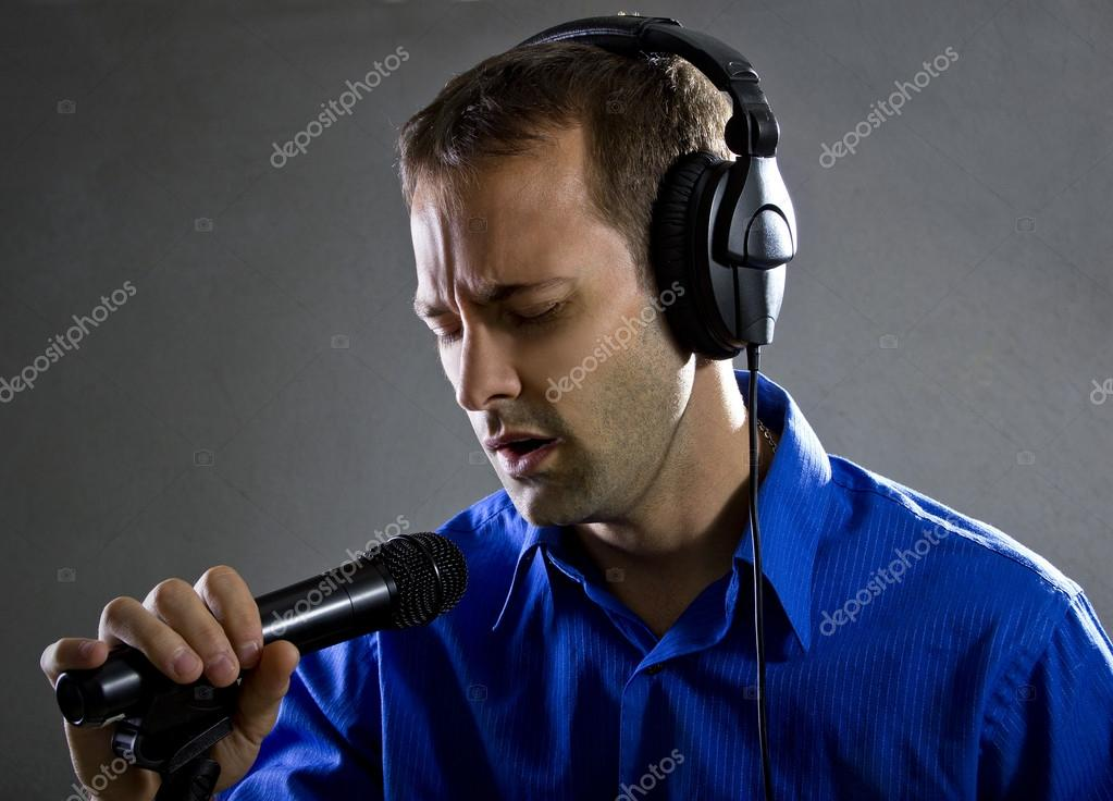 Male voice over artist on a microphone — Stock Photo
