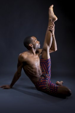 man doing yoga stretches