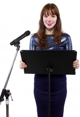 Girl speaking into a microphone