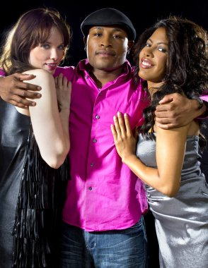 Man with two women at nightclub