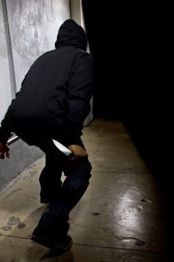 criminal with a knife hiding