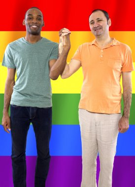 homosexual couple with a rainbow gay pride flag
