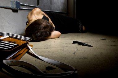 Female lying dead on a street alley