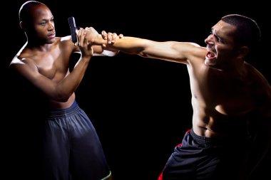 Martial artist disarming criminal with gun
