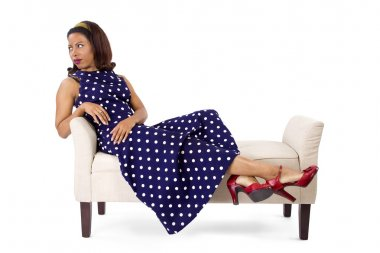 Woman in vintage dress on chaise lounge