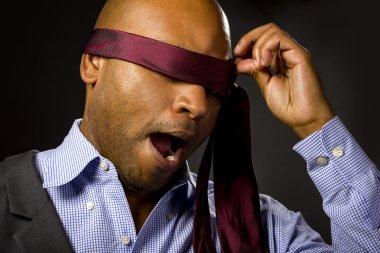 Black businessman blindfolded