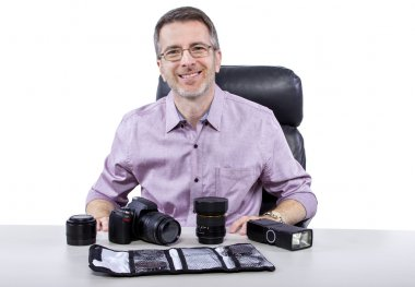 Professional photographer showing camera gear