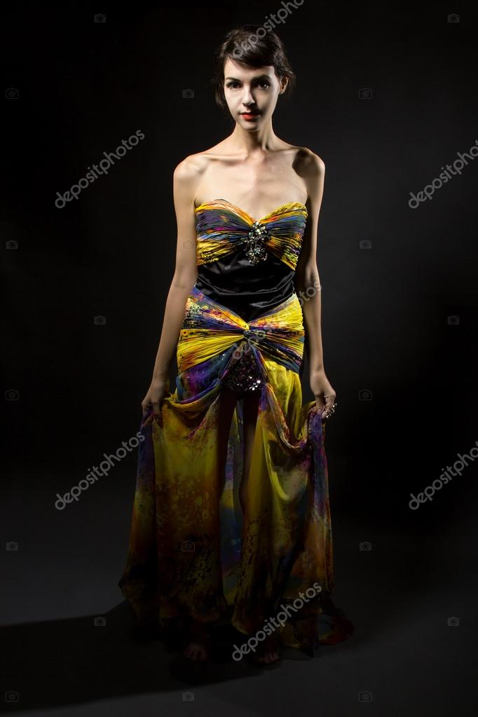 5ef6f626 Young woman wearing fashionable yellow silk tie dye dress — Photo by  innovatedcaptures