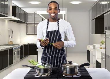 chef standing in apron in restaurant kitchen