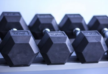Sports dumbbells in modern sports club