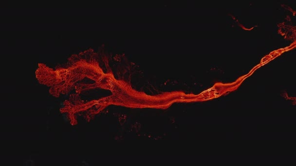 Aerial birds eye overhead top down view of amazing orange textured pattern of lava stream against black background. Fagradalsfjall volcano. Iceland, 2021