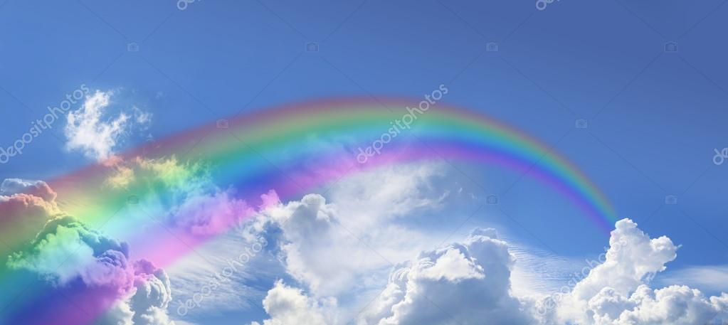 Rainbow on wide blue sky