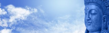 Buddha on blue sky website header