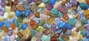 Multicolored tumbled crystal stones background