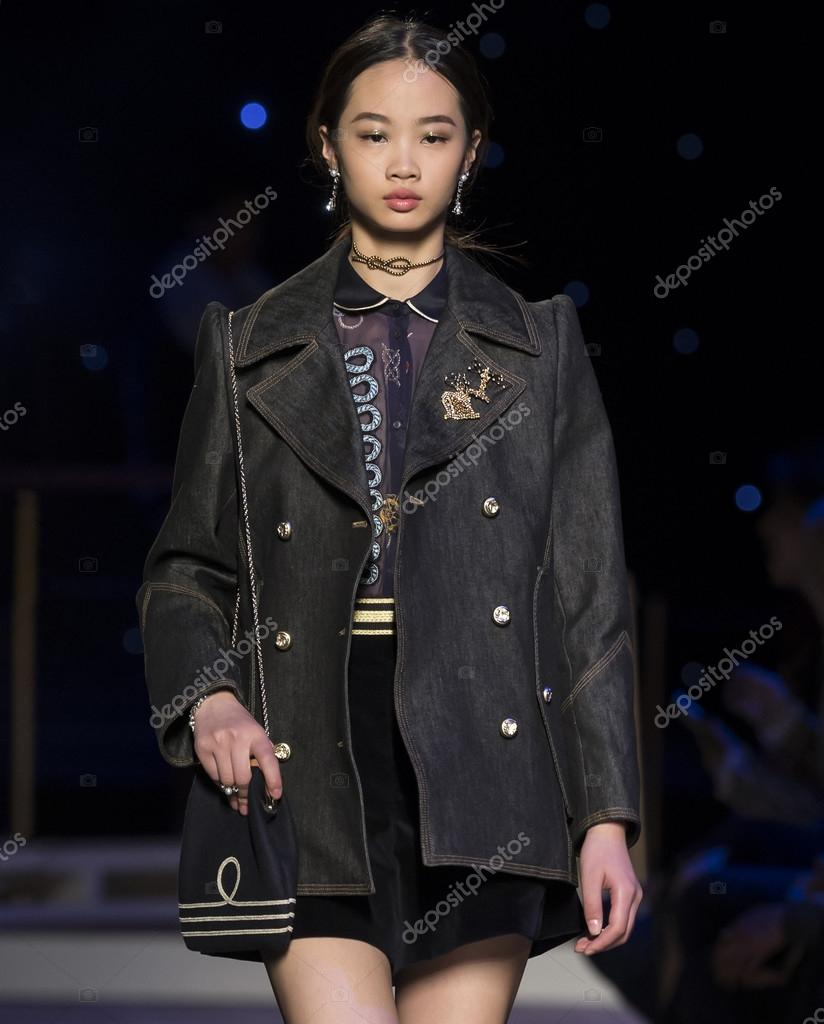 e4c19fa7 New York City, USA - February 15, 2016: A model walks the runway during the Tommy  Hilfiger Women's show as a part of Fall 2016 New York Fashion Week at Park  ...
