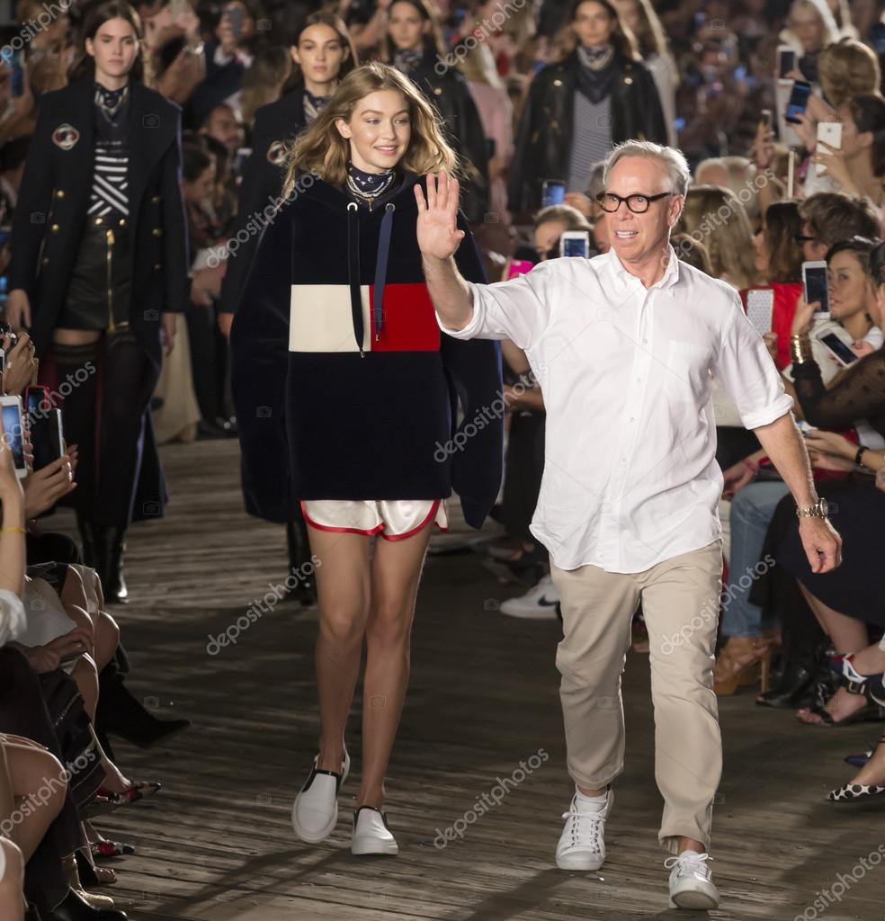 e6a09090 NEW YORK, NY - SEPTEMBER 09, 2016: Gigi Hadid and designer Tommy Hilfiger  walk the runway at Tommy Hilfiger Women's Fashion Show during New York  Fashion ...