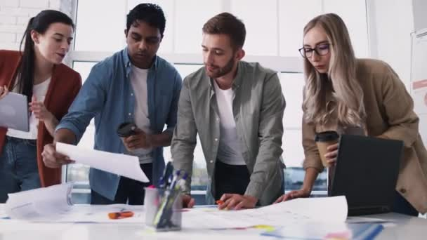 Creative Team Working on Table. Creative Office Work. Team Discussing Ideas. Architecture Table Work. Shot on RED