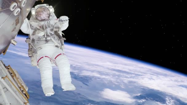 Astronaut working on space station above the Earth.