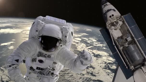 Astronaut and shuttle above the Earth