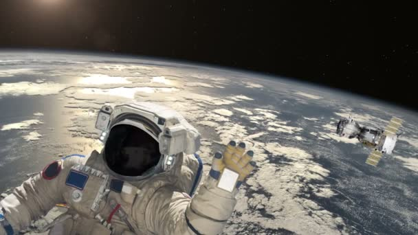 Astronaut and satellite  above the Earth .