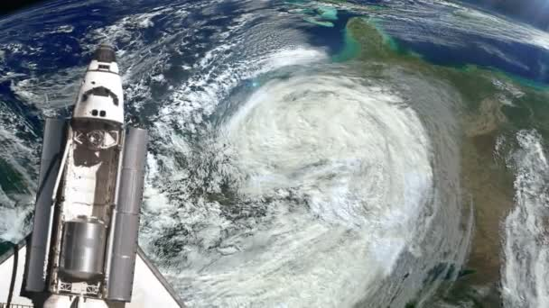 The Space Shuttle above the Earth and a hurricane.