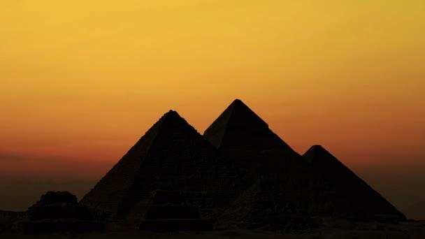 Timelapse. Sunrise over pyramids. Giza Egypt.