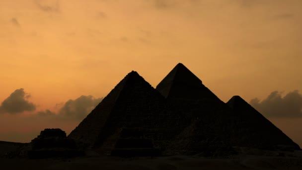 Timelapse. Sunrise over pyramids in Giza Egypt.