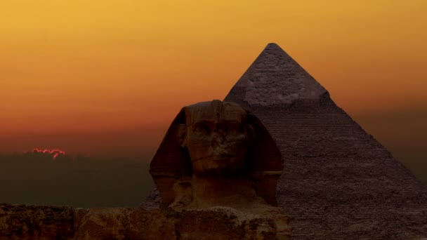 Timelapse. Sunrise over the pyramid of Cheops and Sphinx. Giza Egypt.
