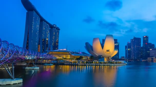 Timelapse of Cityscape view with sunset and twilight time main light color showplaces, view marina bay and helix bridge landmark