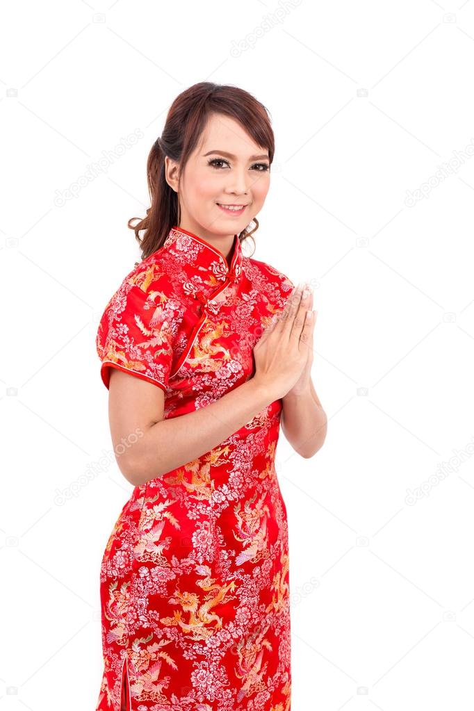 Asian chinese girl greeting in traditional chinese welcome guest asian chinese girl greeting in traditional chinese welcome guest put the palms of the hands together in salute thai chinese new year powerbee photo m4hsunfo