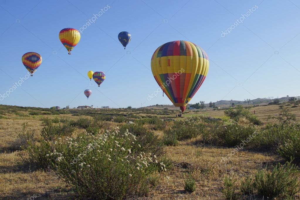 Balloons landing at 2015 Temecula Balloon and Wine Festival outside of Los Angeles, California