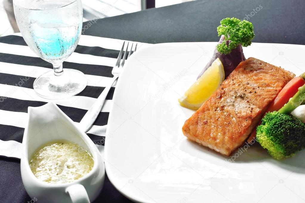 salmon steak on dinner table.