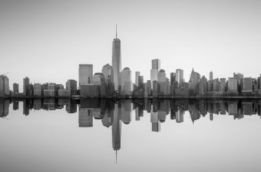 Manhattan Skyline with the One World Trade Center building at tw