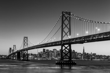 San Francisco skyline and Bay Bridge at sunset, California USA stock vector