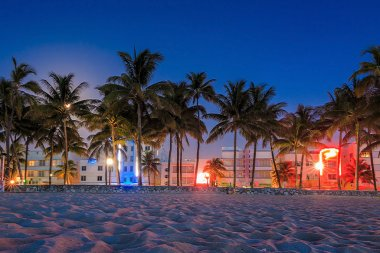 Miami Beach, Florida hotels and restaurants at twilight on Ocean